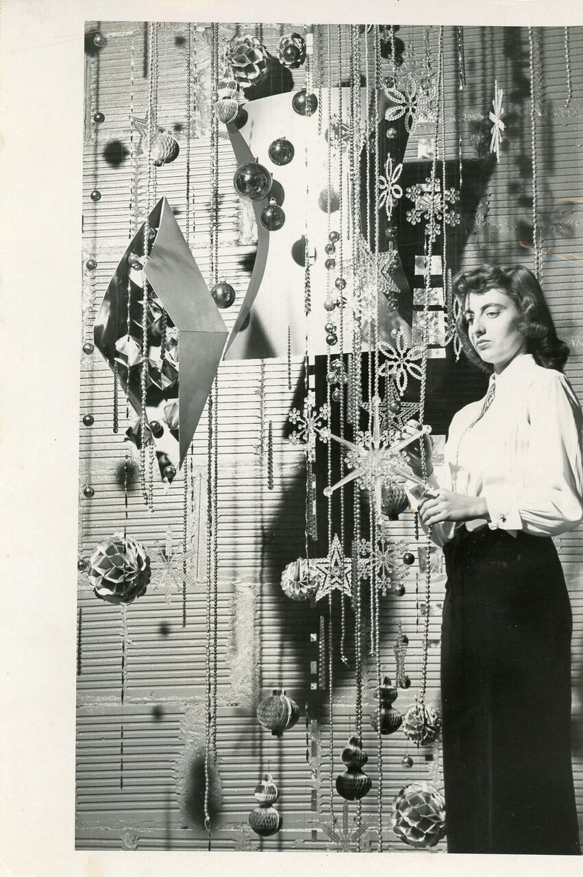 Jerri Hodges Bonebrake standing next to the Christmas tree